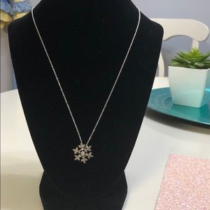 A diamond and silver necklace
